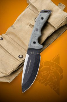 """Outpost Command Blade Length: 5 3/4"""" O/A Length: 11 1/4"""" Cutting Edge: 5"""" Thickness: 1/4"""" Weight: 22oz Blade Color: Black Traction Coating Blade Steel: 1095 High Carbon Alloy RC-58 Handle Material: Black Linen Micarta® Sheath: Combat Ballistic Nylon Weight: 18.0oz Weight w/ Sheath: 23.1oz Mfg. Handcrafted in the USA"""
