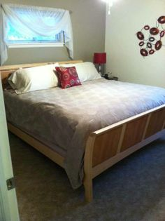 Two Toned Wood on the Sarah Sleigh Bed against a Grey Bedroom Wall. A casual and comfortable chic look.