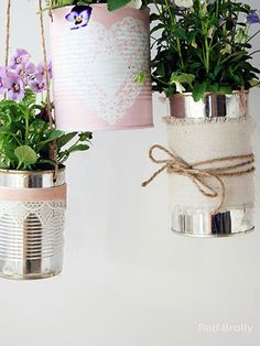 Who would've guessed that these delicate hanging planters are actually old tin cans?