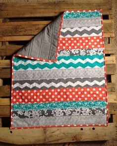 Coral grey and teal chevron baby quilt, Love this quilt!! A friend actually saw it & sent me the link in a text because it reminder her of our nursery. :)