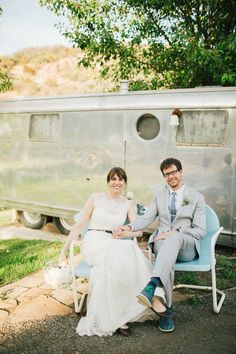 newlyweds with a vintage airstream // photo by Sweet Little Photographs, styling by Sitting in a Tree Events, flowers by The Little Branch // View more: http://ruffledblog.com/copper-and-white-malibu-wedding/