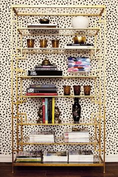 Wallpaper and gold art deco style bookcase