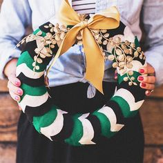 We are loving this fun + modern take on a wreath! Pretty felt pattern and gold embellishment.