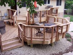 Redwood deck with unique shapes and plenty of built-in seating areas designed by @DeckTec Outdoor Design Outdoor Design
