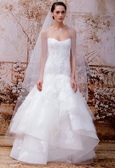 Ambiance~Distinctive Weddings & Events A Monique Lhuillier Wedding Dresses Spring 2014 Photo c/o The Knot  (410) 819-0046