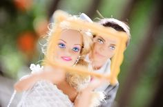 Barbie and Ken do classic wedding picture frame shot!