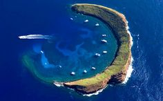 This is the real picture of: STRANGE ISLAND OF MOLOKINI - NATURAL STAR AND CRESCENT - BETWEEN MAUI & KAHOOLAW, HAWAII. Why do people have to post fake pics!!!
