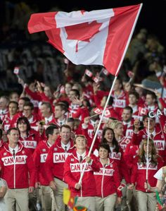 Two-time triathlon medallist Simon Whitfield leads the Canadian Olympic Team into the Olympic Stadium!