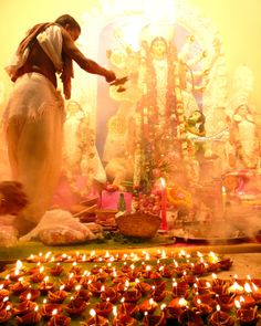 Navratri: The feminine divine form is celebrated with candle lit processions, cooking, dancing, singing, water & sky lanterns, and even burning effigies of evil.