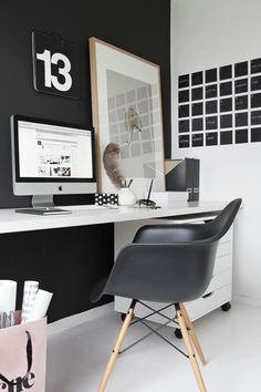 Black wall and eames armchair in workspace, Stylizimoblog.com