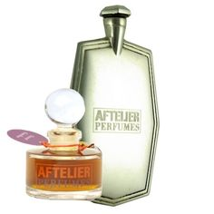 secret garden perfume with silver flask aftel
