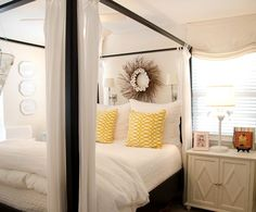 Oyster Shell Twig Wreath over Canopy Bed: http://beachblissliving.com/above-bed-decor-shelf-ideas-art-more/