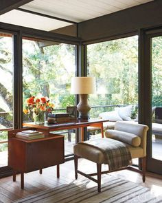 CALIFORNIA STYLE WITH AN ASIAN TWIST    A Danish teak-and-leather chair and a chest of drawers in the master bedroom are vintage, and the throw is by Sandra Jordan.