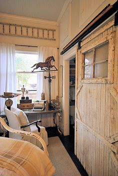 Farmhouse equestrian bedroom, barn door used as bathroom door.