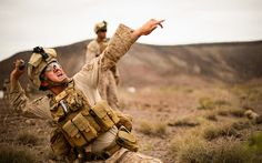 Frag Out — Marine throws a training grenade during a live fire and movement grenade training in Djibouti Feb. 18, 2014. (U.S. Air Force photo by Staff Sgt. Staci Miller/Released)