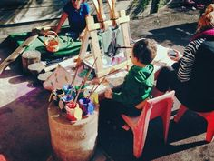 """Painting outdoors at Elder Street Early Childhood Centre ("""",)"""