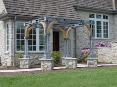 steel and oak pergola on stone piers
