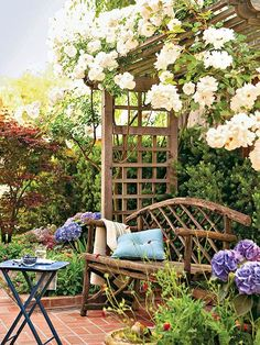 Small-Space Landscaping Ideas:  Add a trellis or abor; add sweet climbing plants (white rose shown here); add a bench . . . and relax :)