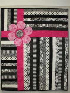 Great idea for a quilt, replace the flower with a race car (or another shape) for a boy. TO TRY: yellow and green for John Deer theme.