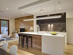 love this timber with white kitchen