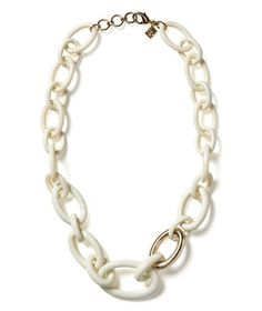 Banana Republic Ivory Enamel Necklace  Against a white top, this chain offers subtle polish. But pair it with a dark color (like navy) or a bright (like fuchsia), and watch it go totally glam.