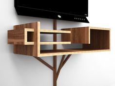 """Tree 2.0 is an all-in-one solution for organizing your TV entertainment peripherals that's perfect for wall-mounted systems. The """"branches"""" of the tree hide unsightly cables all the way from the base to the canopy where receivers, DVD players or gaming systems are supported by multi-level shelves. Designer: Hall Design idea, tree forts, organ, tv furniture, tree 20, cords, branches, bedroom, canopies"""
