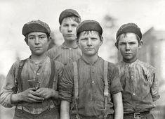 "January 1909. Macon, Georgia. ""Some doffer boys."" These boys worked in a cotton mill, removing  (""doffing"") and replacing thread bobbins when they were empty. Photograph by Lewis Wickes Hine for the National Child Labor Commission. Some Doffer Boys: 1909"
