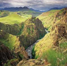 Hells Canyon, which is on the border of Idaho and Oregon is the deepest river gorge in North America. The geologic history of the rocks of Hells Canyon began 300 million years ago with an arc of volcanoes that emerged from the waters of the Pacific Ocean.