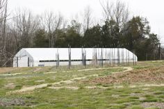 The hoophouse across the fields after a cold March.