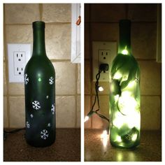 Finally did it. Drilled hole, spray painted it frosted, fetched YouTube video about taking the female end off of the Christmas lights, took the end off of christmas lights, put lights in the bottle, painted snowflakes... Voila!! Winebottle lamp for Christmas.