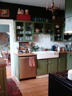 I think I am a big fan of beadboard in kitchens. I just want a farmhouse. Featured on Apartment Therapy.