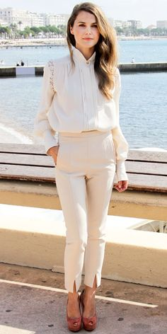 Kerri Russell in off white blouse and cream high waisted trousers.
