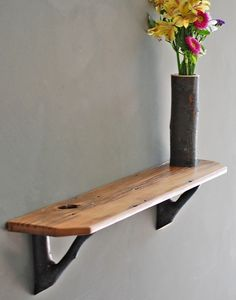 like the natural branch to hold the shelf