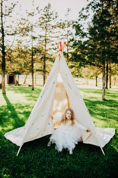 flower girl + play tent, photo by Lev Kuperman http://ruffledblog.com/kaaterskill-ny-wedding #weddingideas #flowergirls
