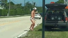 Hunky Guy Distracts Traffic In A Speedo |