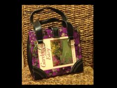 "Bag made from book cover.  Like many books that have a three ring binding, this book lost many pages and could no longer circulate.  By cutting apart a ripped purse, a book/purse hybrid ""bag"" was made with the help of hot glue. The cover of an art or fashion book could make a beautiful bag!"