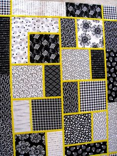 """The Big Block Quilt"", pattern by Minay Sirois from Black Cat. [I wouldn't have thought I'd like Black  White with a Yellow accent so much, but it's great with this pattern!]"