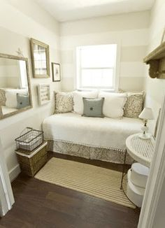 A twin bed looks like a couch in a guest or baby room. I really like the stripes. They're not a drastic contrast, very mellow.