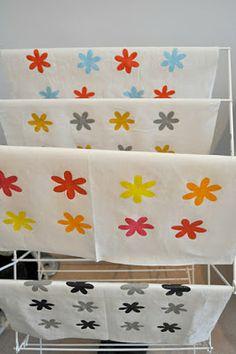 DIY stencilling on fabric tea towels.