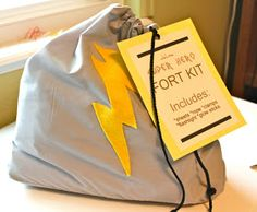 """Awesome gift for your SUPER KID!! """"Super Hero Fort"""" Kit-  -2 Twin sheets: ARC for about $2 each -Ties on the Sheet: old XL T-shirt -Rope: Hobby lobby for about $2 -Flash Light: Dollar Store $1 -Clamps: Dollar Store $1 -Glow Sticks: Dollar Store $1 -Clothes Pins: Dollar Store $1 -Suction Cups: Dollar Store $1 -Lightening Bolt bag: inexpensive gray fabric, yellow felt ~$3-4 What kid doesn't love building a fort?? What an awesome gift!!"""