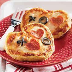 Re-creating these mini heart-shaped pizzas would be a fun family affair for dinner on Valentine's Day.
