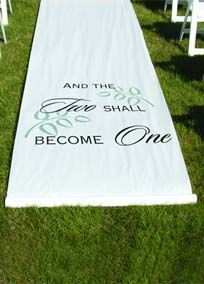 """Begin your walk down the aisle with the phrasing of this remarkable aisle runner. Made of white, durable fabric, the aisle runner features wording """"And The Two Shall Become One"""" printed in black and a leaf design printed in grey. Design is printed 8' from the beginning of the runner. Wording faces the aisle entrance. Adhesive strip at the top of the runner secures it to the flooring.  Features and Facts:   36"""" wide x 100' long with pull cord  White fabric made of Rayon"""