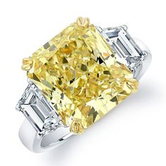 Platinum and 18k yellow gold ring with radiant-cut fancy intense yellow diamond center stone and trapezoid-shaped white diamond side stones, Rahaminov