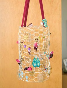 Cool take on the chicken wire jewelry organizer.