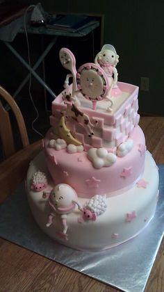 Pink nursery rhyme baby shower cake
