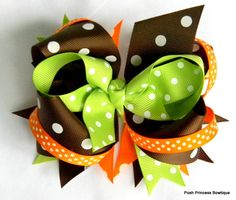 Brown orange green Fall hair bow Stacked boutique hair bow. $12.00, via Etsy.