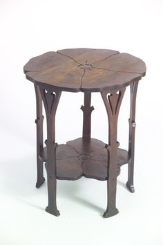 """Stickley Antique of the Week: Poppy Table  The model #26 Poppy Table was one of the earliest Arts & Crafts designs from Gustav Stickley's Company. It was produced for a very short time in 1900 and reveals the English roots of the blossoming American Arts & Crafts Movement. Gustav said of this table, the """"…motive for decoration is based on natural forms…where the legs suggest the stem of a plant while the tops reproduce the lines of an open flower."""""""