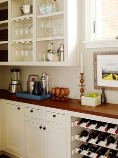 inset white cabinets with wood counters