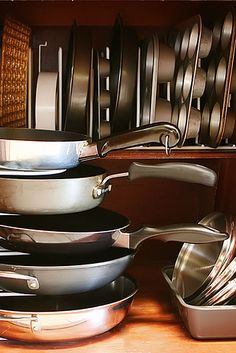 Use pan organizers both horizontally and vertically to maximize storage space in your kitchen cabinets.   52 Meticulous Organizing Tips For The OCD Person In You