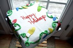 Holiday Sweet!  This is an 11- inch square 2-layer sweet iced in buttercream icing ($67.50 and additional customization charges) and topped with fondant accents.  This cake serves 38-45.  www.pinkpiggysweets.com